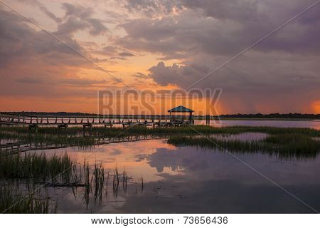 dock at sunset with approaching storm, Beaufort, South Carolina
