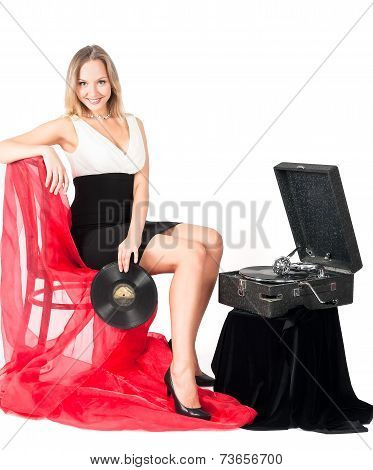 Pretty blonde woman with gramophone