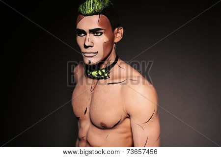 Muscular Man With Painted Face And Chest