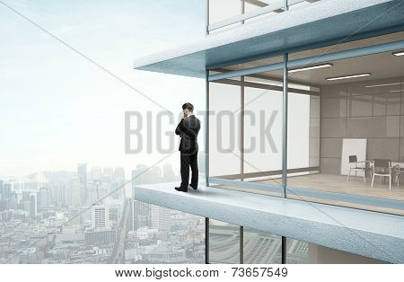 Businessman Standing On Skyscrapper