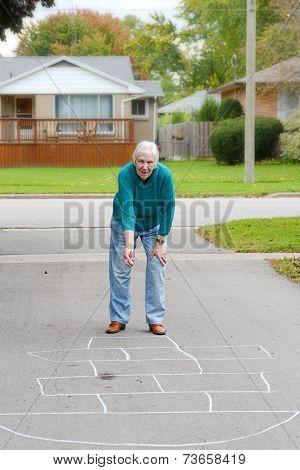 senior woman playing child's game