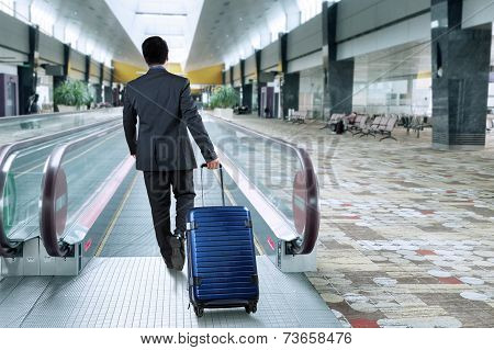 Business Person Walk Toward Escalator