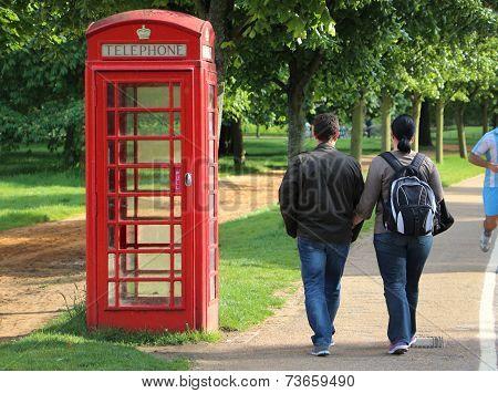Couple Walk On Kensington Gardens