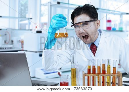 Ridiculous Scientist With Chemistry Liquid