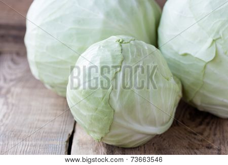 Head Of Cabbage On Wooden Background