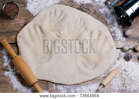 Adult And Baby Handprints On Rolled Out Dough With Rolling Pin