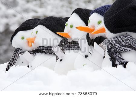 Line Of Carol Singing Snowmen