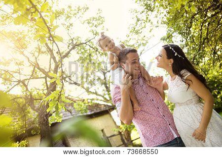 Pregnant family in garden