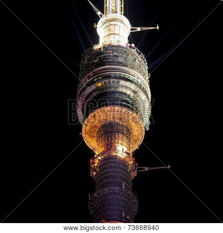 Ostankino television tower at night time in Moscow.