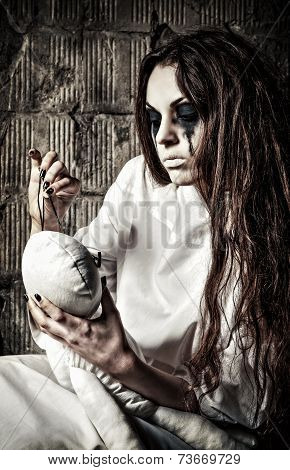 Horror Scene: Strange Crazy Girl With Moppet Doll And Needle In Hands