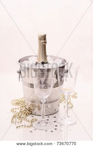 Champagne Bottle In Cooler, Two Champagne Glasses