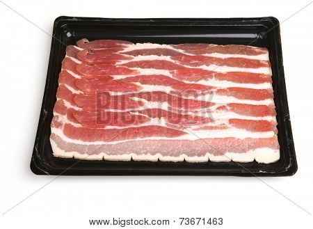 Bacon strips in plastic packaging tray