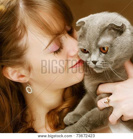 Young woman with scottish-fold cat