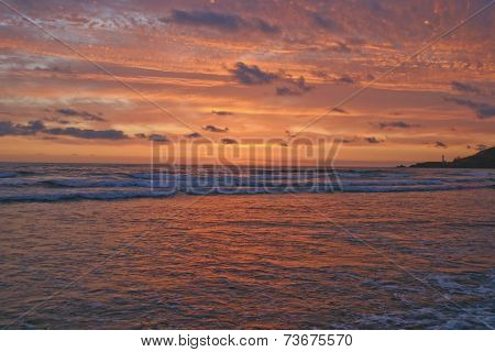 California Lighthouse Amid A Magnificent Ocean Cloudscape