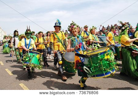 HASTINGS, ENGLAND - MAY 5, 2014: The Sambalanco samba band perform during a parade on the West Hill at the annual Jack In The Green festival. The festival marks the May Day public holiday in Britain.