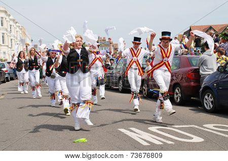 HASTINGS, ENGLAND - MAY 5, 2014: Mad Jack's Morris dancers perform at the parade on the West Hill during the annual Jack In The Green festival. The event marks the May Day public holiday in Britain.