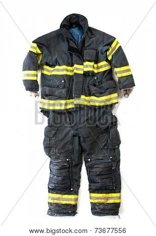 A pair of used worn firefighter pants and suit isolated display on white background