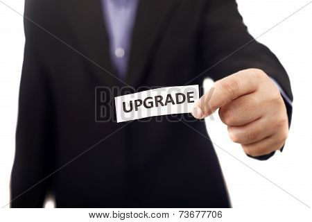 Man Holding Paper With Upgrade Text