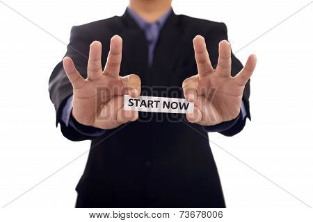 Man Holding Paper With Start Now Text