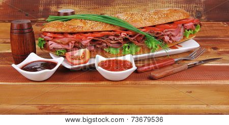 sandwich : fresh white french baguette with chicken smoked sausage on wood