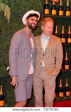 LOS ANGELES - OCT 11:  Justin Mikita, Jesse Tyler Ferguson at the Fifth-Annual Veuve Clicquot Polo Classic at Will Rogers State Historic Park on October 11, 2014 in Pacific Palisades, CA