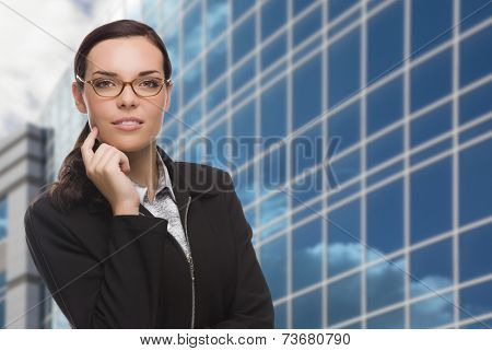 Confident Attractive Mixed Race Woman in Front of Corporate Building Outside.