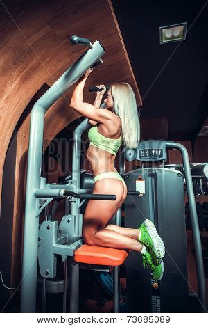 Woman working out in gym - pull ups