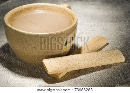 Cup of milk coffee with crusty sticks