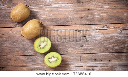 Kiwis on wooden background