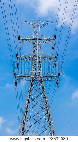 High Voltage Power Pole With Blue Sky Background For Power Transmission.