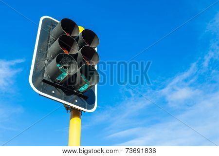 The Traffic Lights And Little Cobweb Against Blue Sky Backgrounds.
