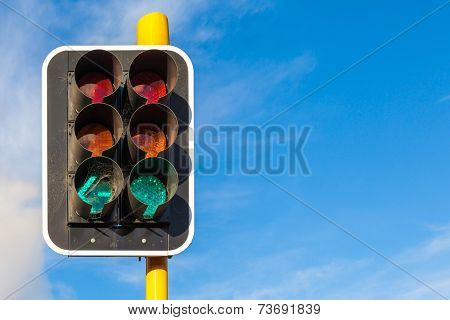 The Grungy Traffic Lights With Beautiful Blue Sky In Backgrounds.