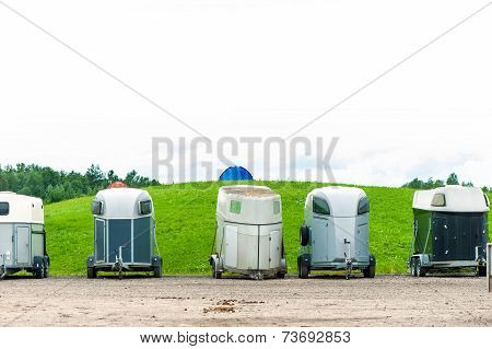 Many Horse Trailers In The Green Park Outdoors.