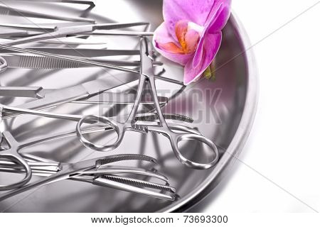 Surgical Instruments Orchid On White With Orchid