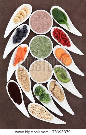 Super food selection  for body builders in white porcelain bowls.
