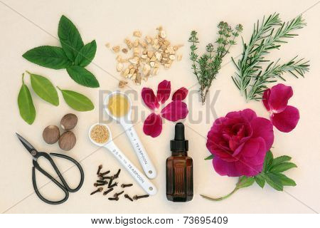 Love potion ingredients with dropper bottle, measuring spoons and scissors over mottled cream background.