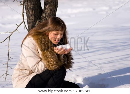 Adult Young Woman Lick The Snow In Handfuls