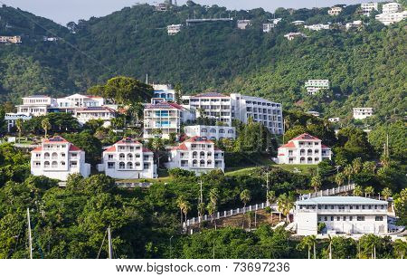 Luxury White Stucco Condos On Green Tropical Hillside