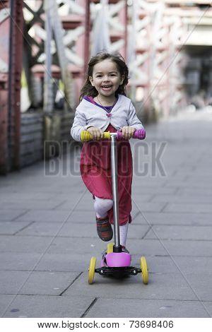 Little Girl Ridding Scooter