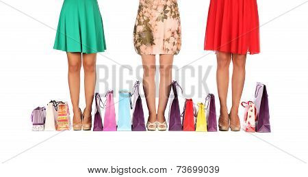 Legs Of Three Glamorous Girlfriends With Paperbags