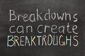 foto of breakdown  - breakdowns can create breakthroughs phrase handwritten on blackboard - JPG