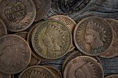pic of copper coins  - Extreme close up view of One Cent vintage coins on rustic wood - JPG