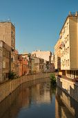 stock photo of costa blanca  - Old town buildings alongside a canal Orihuela Costa Blanca - JPG