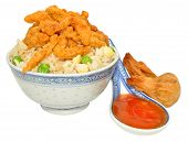 image of crispy rice  - Chinese crispy beef and rice in a decorated bowl with chilli sauce - JPG