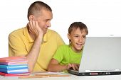 foto of homework  - Father helping his son with his homework