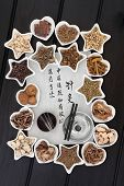 Chinese herbal medicine selection, acupuncture needles and moxa sticks with calligraphy script. Translation describes acupuncture chinese medicine as a traditional and effective medical solution. poster