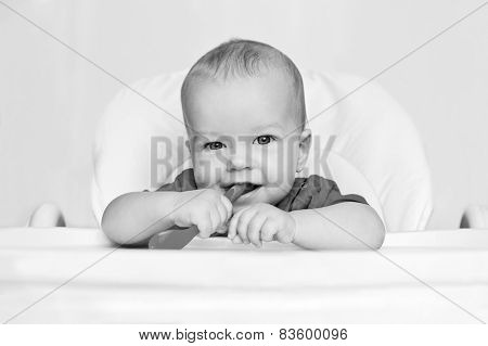 Laughing Boy Holding A Spoon