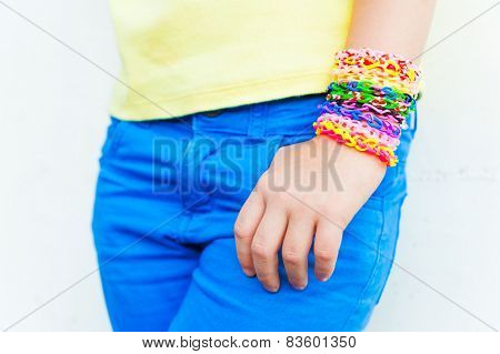 Loom bracelets on a little girl's hand