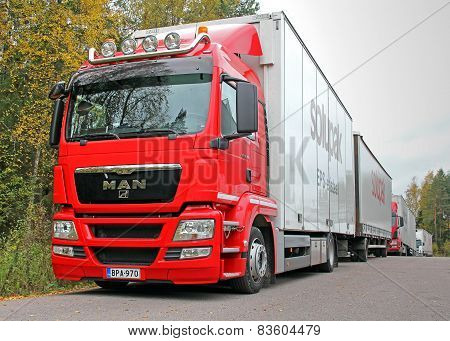 Red Man 18.360 Truck And Full Trailer Parked