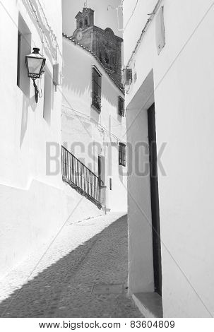 Andalusian Traditional Street With White Wall. Spain